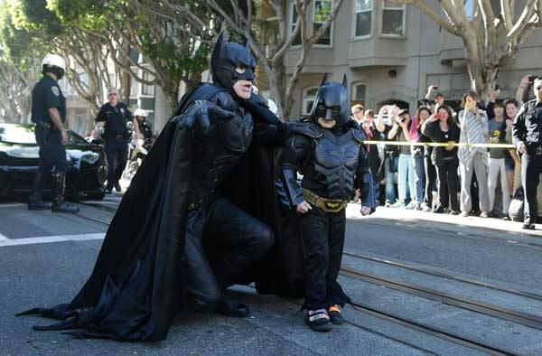 Batkid helping Batman