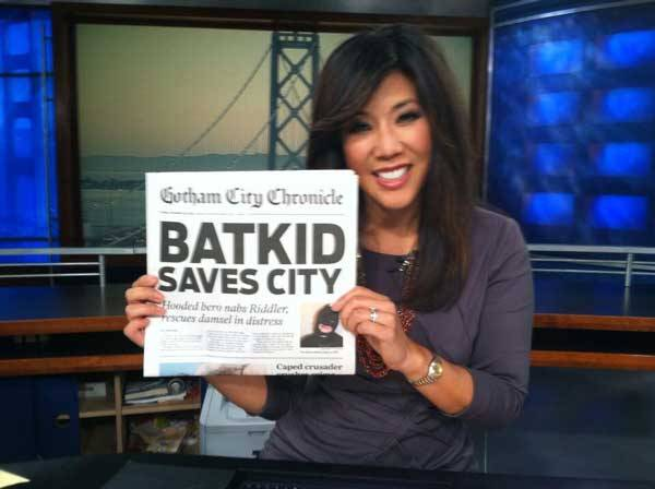 Batkid on the news paper