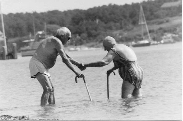 Old Couple Swimming