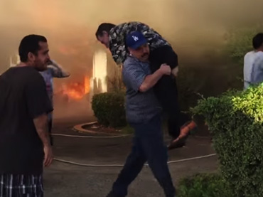 As-His-Home-Went-Up-In-Flames,-This-Man-Was-Carried-To-Safety-By-A-Random-Hero