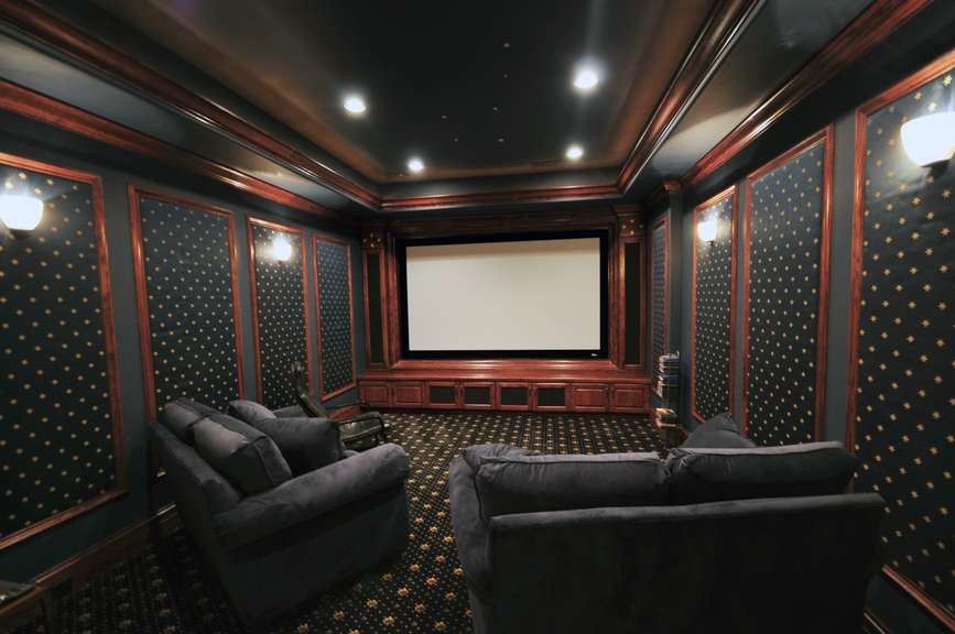 dark media room emulating a real cinema - Home Theater Rooms Design Ideas