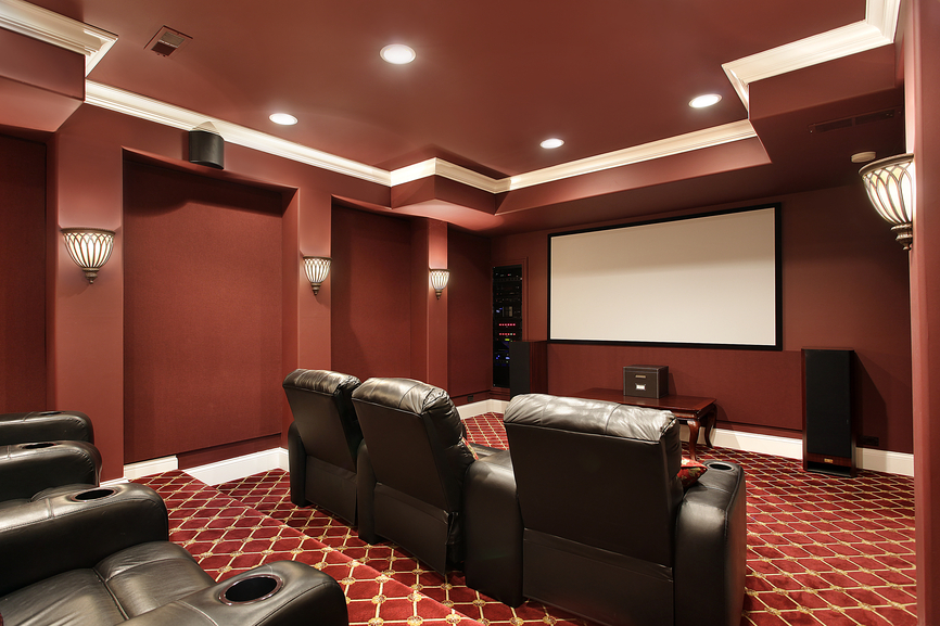Theater Room With Ruby Red Motif And Plush Brown Leather Chairs