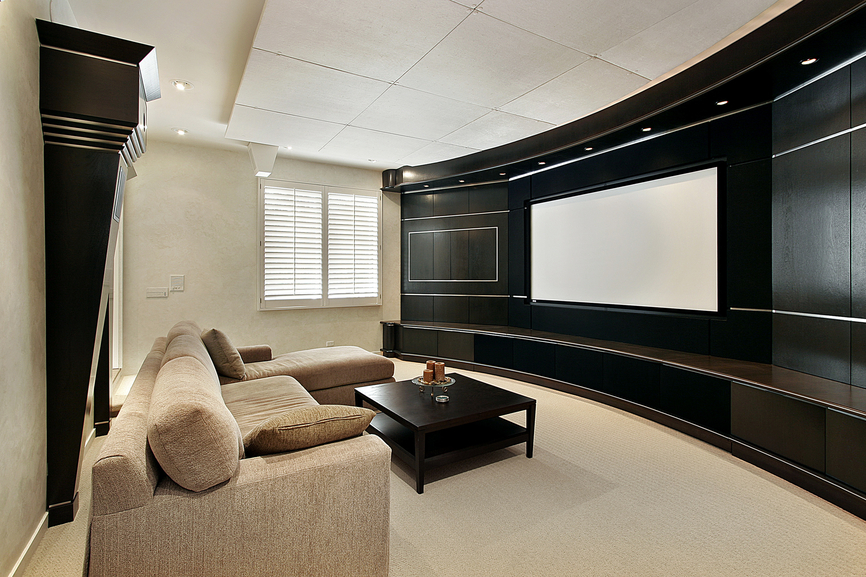 Black, White, And Beige Home Cinema With Sectional Sofa