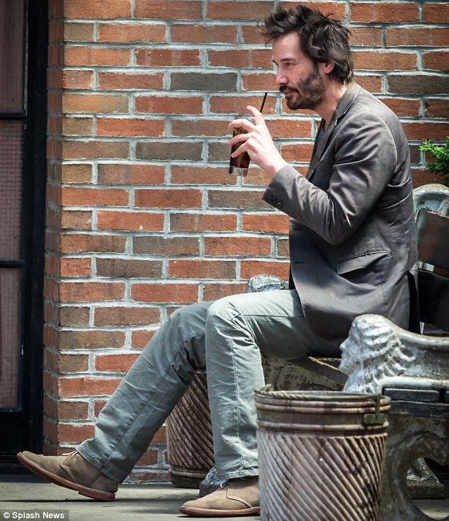 Keanu Reeves drinking
