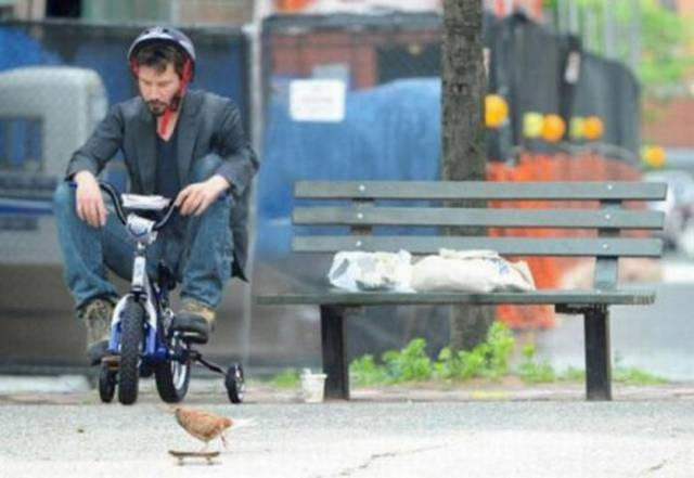 Keanu Reeves on a bike
