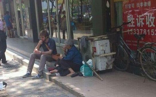 Guy Sharing Fries and Water to Homeless Woman