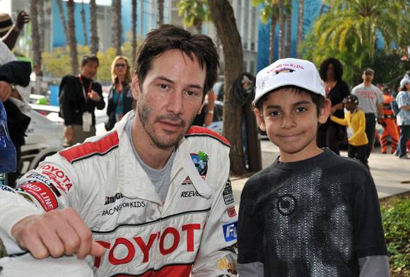 Keanu Reeves with a kid