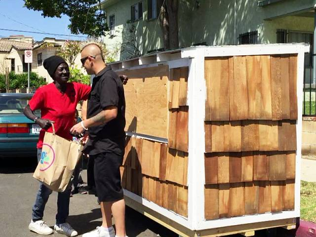 Elvis Summers building house for homeless woman