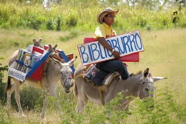 Luis Soriano riding donkey