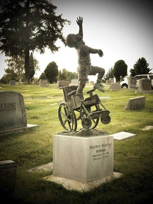 "A father had this tombstone designed and made for his wheelchair-bound son depicting him ""free of his earthly burdens."""