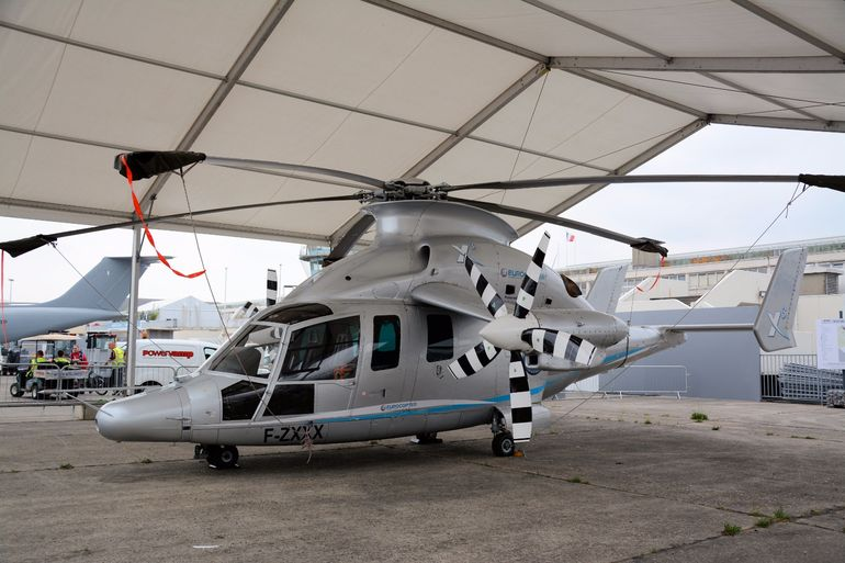 "A <a href=""http://www.gizmag.com/eurocopter-x3-speed-record/27946/"">Eurocopter X3</a> hybrid helicopter demonstrator tucked away behind the main static displays at the Paris Air Show"
