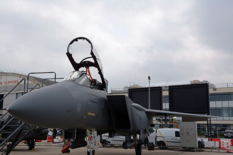 A US Air Force F-15E - Strike Eagle - is capable of Mach 2.5+ and has room for a pilot and weapons system officer