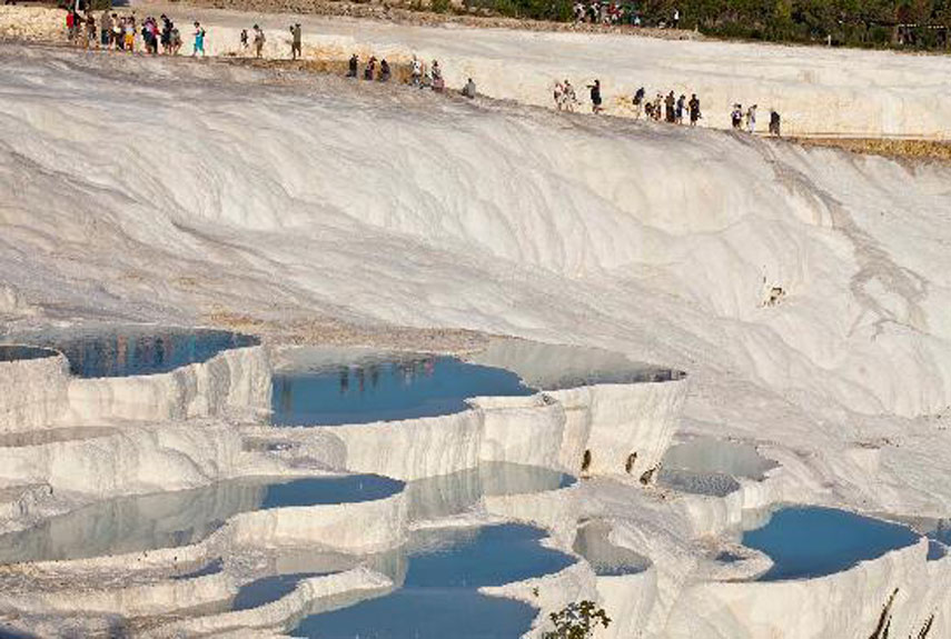 Where: Turkey The white terraces inside these pools are enough to take the first-time visitor's breath away. The bright white calcium and limestone deposits act like shelves buried in the water. Much like the Blue Lagoon in Iceland, the pools are praised for their healing powers because of the abundance of minerals in the water.