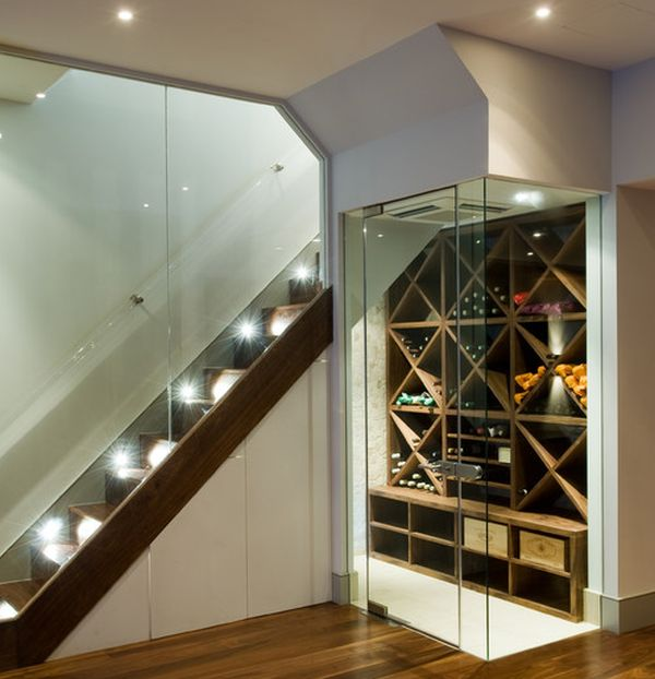 Contemporary temperature-controlled wine room next to the stairs