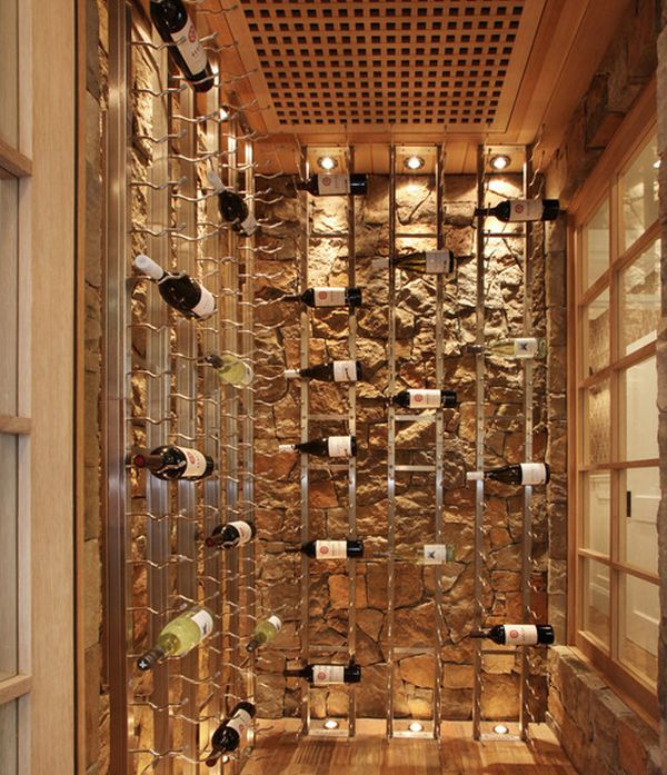Cool wine racks set against a stone backdrop give this cellar an artistic appeal