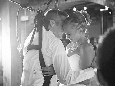 Groom-Surprises-His-Bride-By-Being-Lifted-Out-Of-His-Wheelchair-For-Their-First-Wedding-Dance