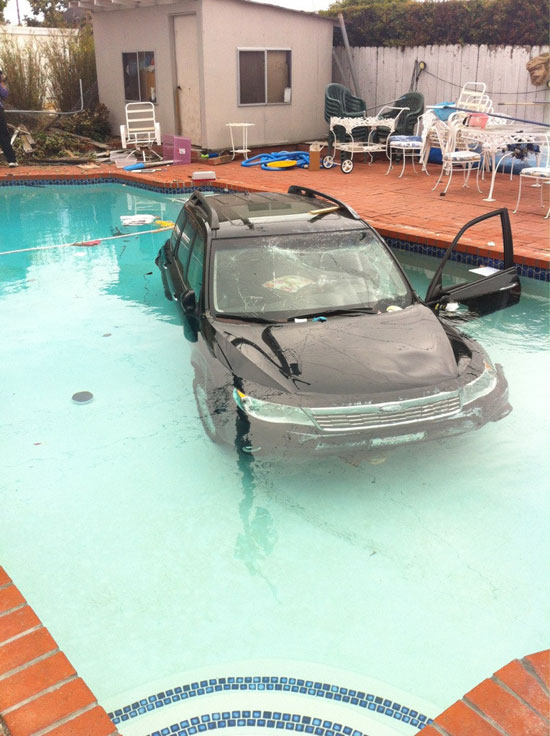 The car wasn't invited to the pool party, but that wasn't going to stop it, apparently.