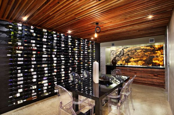 Recycled timber roof and back-lit onyx grace this beautiful wine cellar
