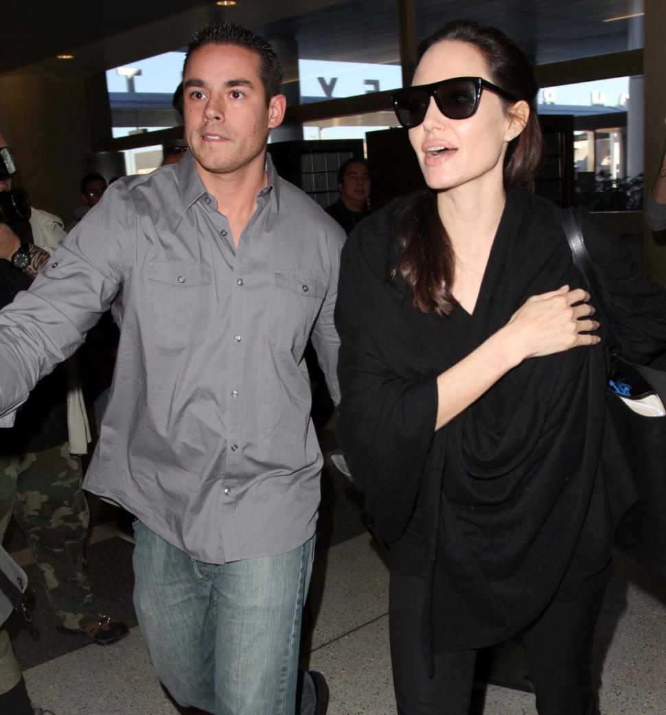 The Jolie/Pitt family is full of bodyguards from the ones watching over them, their children and even their internet! Angelina is notorious for going through bodyguards, especially good looking ones like this hunk that escorted her through LAX back in January.