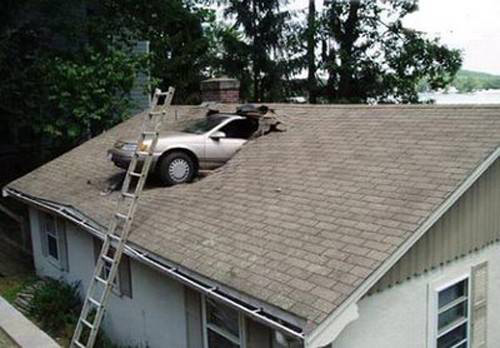 car is embedded in roof