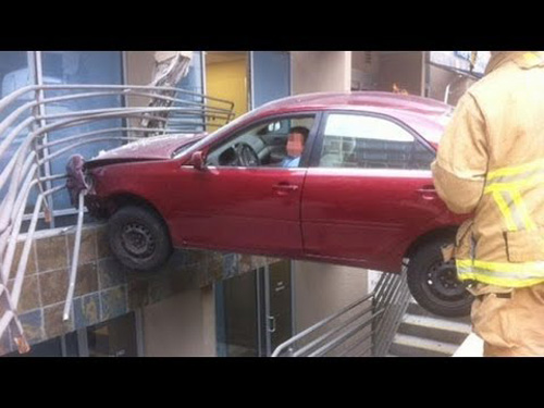 car wedged between railings