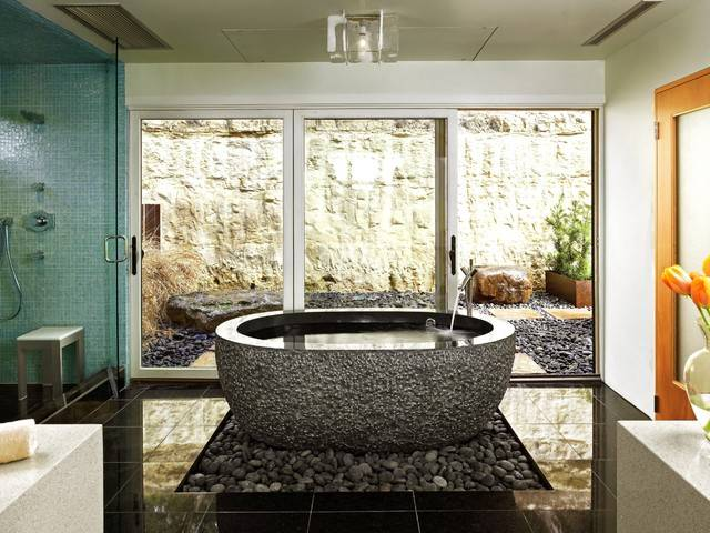 Glass Shower, Glass Tile & Granite Bathtub Placement and Bathroom Color Theme -  Glass Doors,  View to Exterior Garden,  Stand Alone Tub,  River Rocks &  View