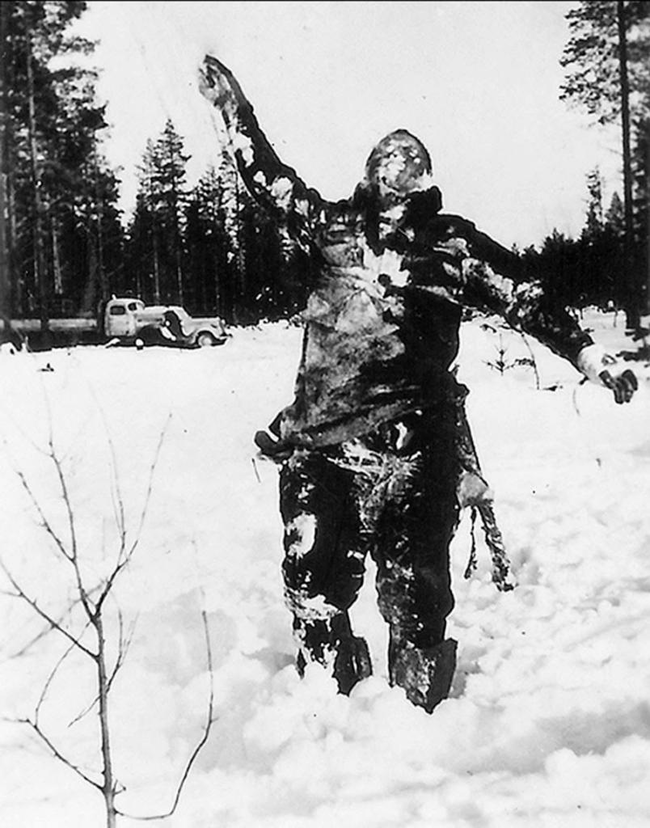 A frozen Soviet fighter propped up by Finnish soldiers to wreak psychological warfare on the invading Soviets.