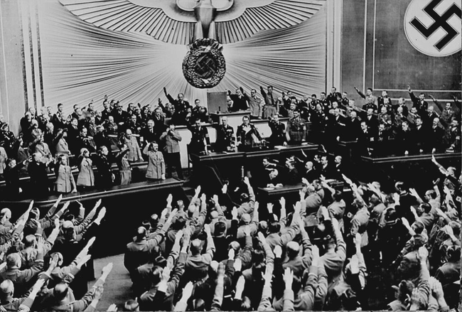 Applause and salutes for Hitler after Germany successfully annexed Austria in 1938.
