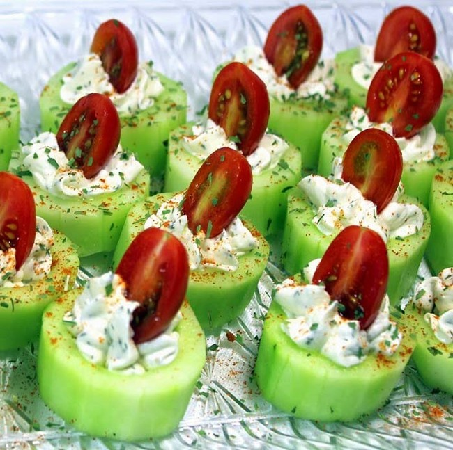 Cucumbers stuffed with herb cream cheese and cherry tomatoes