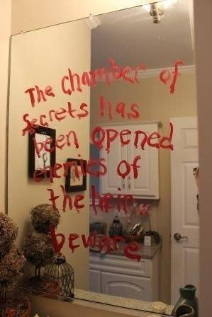 Channel your best possessed-by-Voldemort penmanship and write on all your mirrors with lipstick.