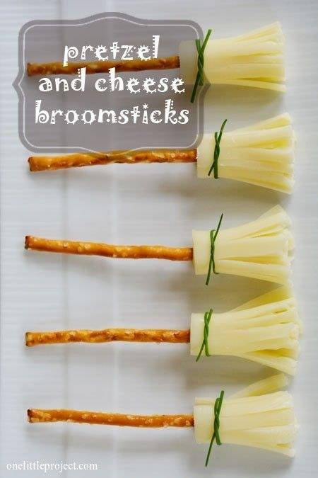 Pretzel sticks, string cheese, and chives make adorable broomstick snacks.
