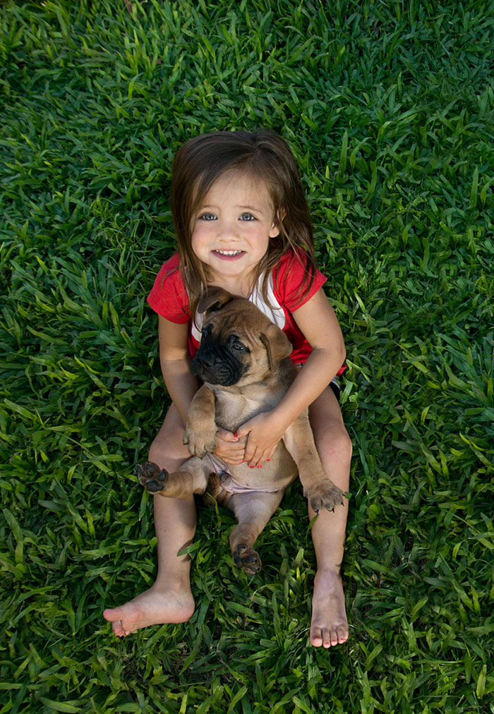 A Girl With Her Puppy