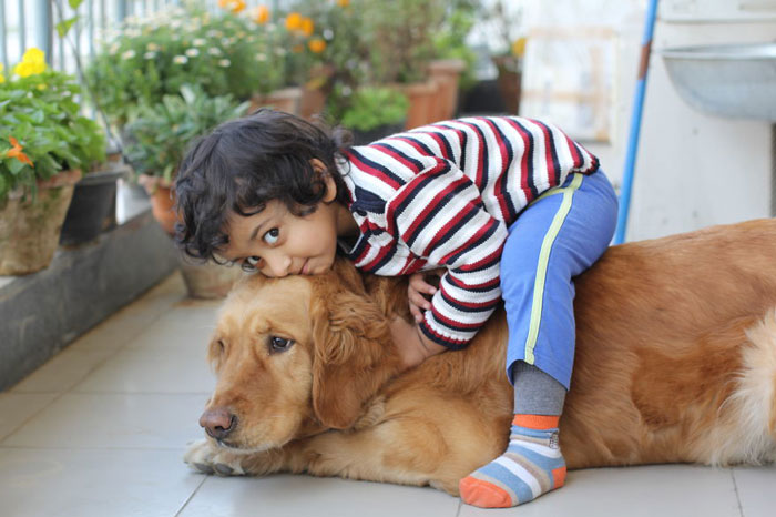 Kid With His Dog