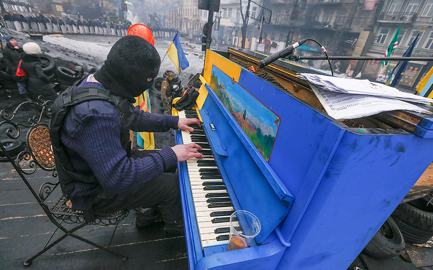 Ukrainian Protester Plays Piano On A Barricade In Front Of The Riot Police Line (Kiev, Ukraine, 2014)