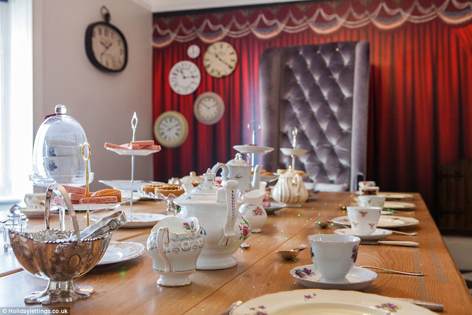 Perfect tea party! The large dining room table comes complete with engraved quotes from the book, with them mirrored on the other side and if you are looking at them through a looking glass