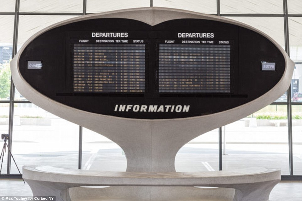 Touhey captured a round capsule departures board at the TWA terminal, as reported by Curbed