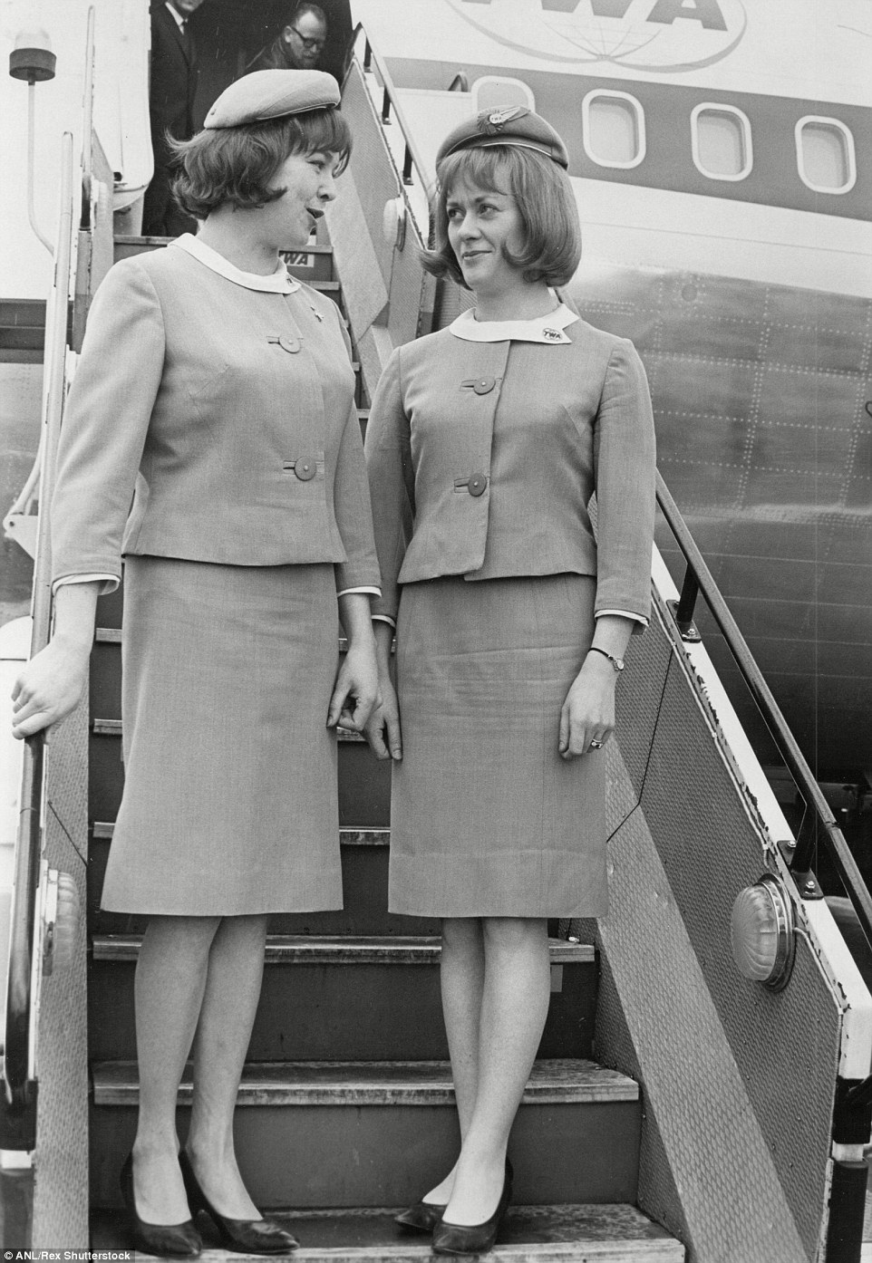 High-flying: Airline hostesses for TWA are pictured welcoming people aboard a flight back in 1966