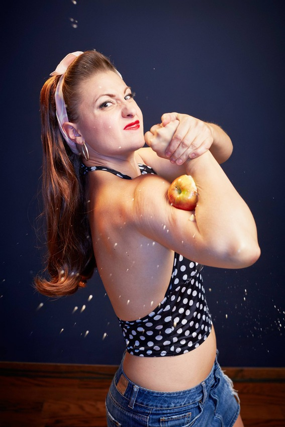 6. Most Apples Crushed With the Biceps in One Minute - Linsey Lindberg