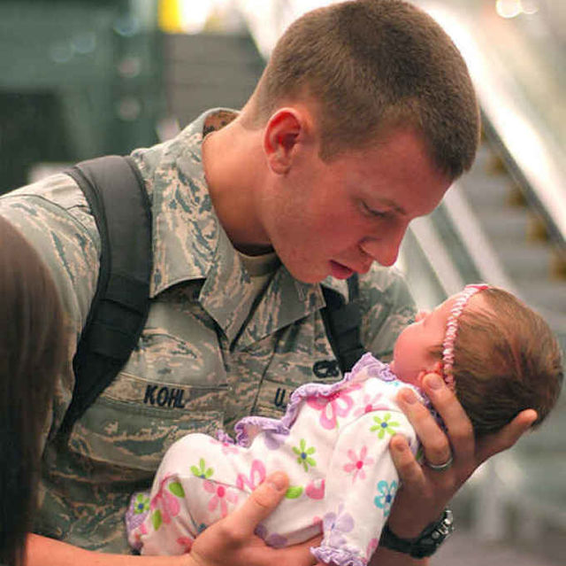 This soldier seeing his daughter for the first time