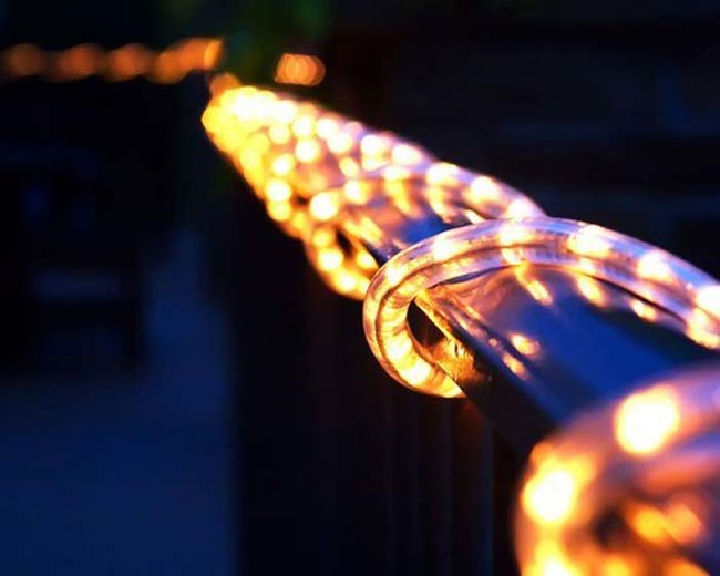 Wrap rope lights around anything outdoors to give it a warm glow.