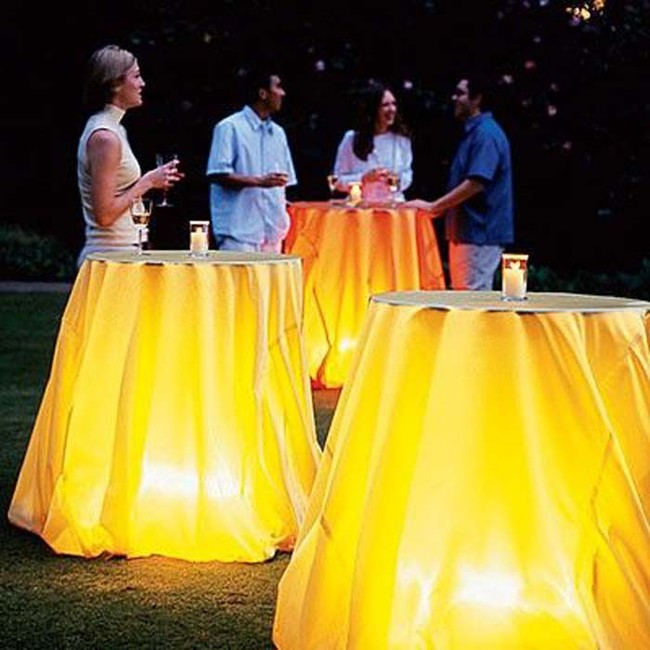 If you're having a summer barbecue, a lamp under a covered table can create a cool ambience.
