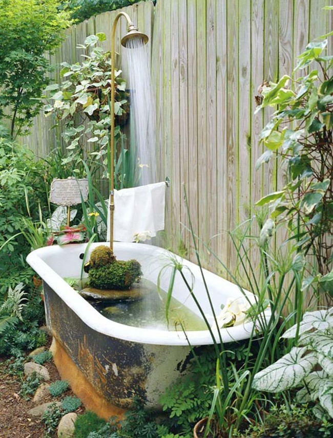 Make an old claw-foot tub into a backyard fountain-pond hybrid.