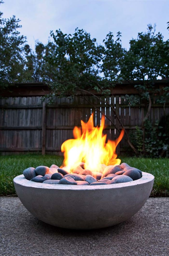 "This fire pit is elegant, but <a href=""http://www.manmadediy.com/users/chris/posts/2618-how-to-make-a-diy-modern-concrete-fire-pit-from-scratch%20from"" target=""_blank"">easy to make</a>."