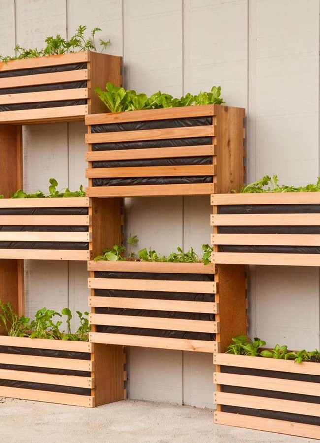 "Make a cool vertical garden like <a href=""http://www.manmadediy.com/users/chris/posts/3582-how-to-make-a-modern-space-saving-vertical-vegetable-garden"" target=""_blank"">this one</a>."