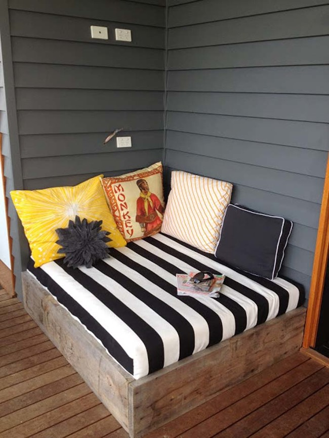 "<a href=""http://apprenticeextrovert.blogspot.com/2012/02/diy-outdoor-day-bed-reveal.html"" target=""_blank"">Make a daybed</a> on your deck and curl up with a good book."