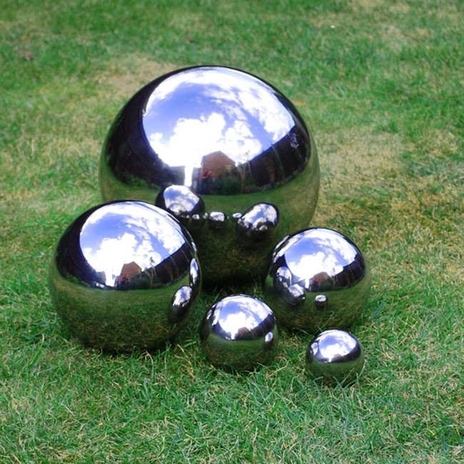 "Spray glass garden orbs with <a href=""http://www.walmart.com/ip/17472671?wmlspartner=wlpa&selectedSellerId=0&adid=22222222227017872768&wl0=&wl1=g&wl2=c&wl3=40940065352&wl4=&wl5=pla&wl6=78877024352&veh=sem"" target=""_blank"">mirror spray paint</a> to give them a makeover."