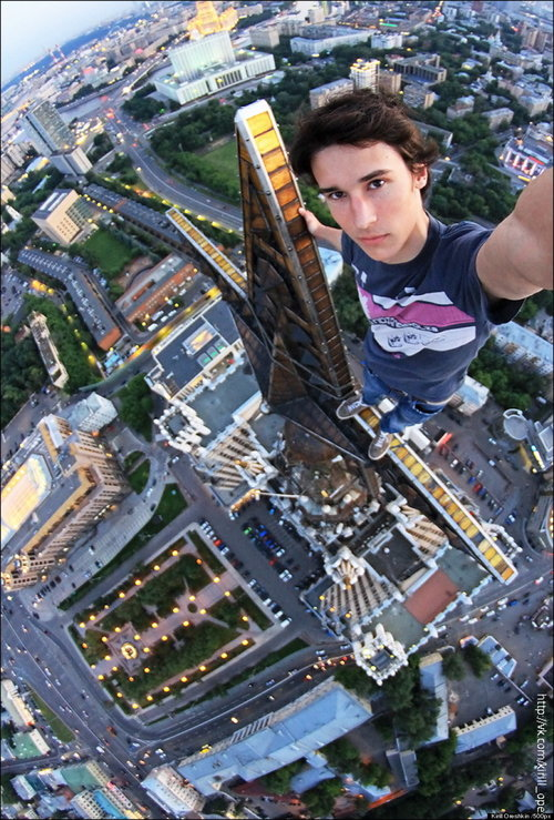 man taking selfie from tall building