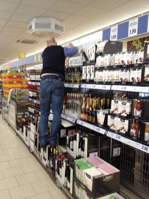 man stepping on wine bottles