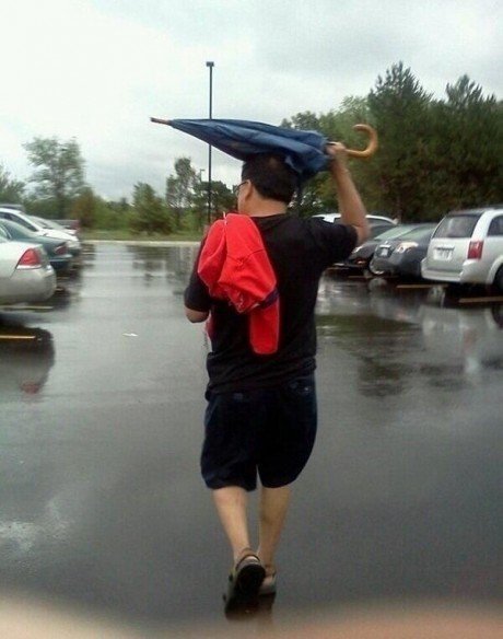 This attempt to stay dry using whatever comes to hand.