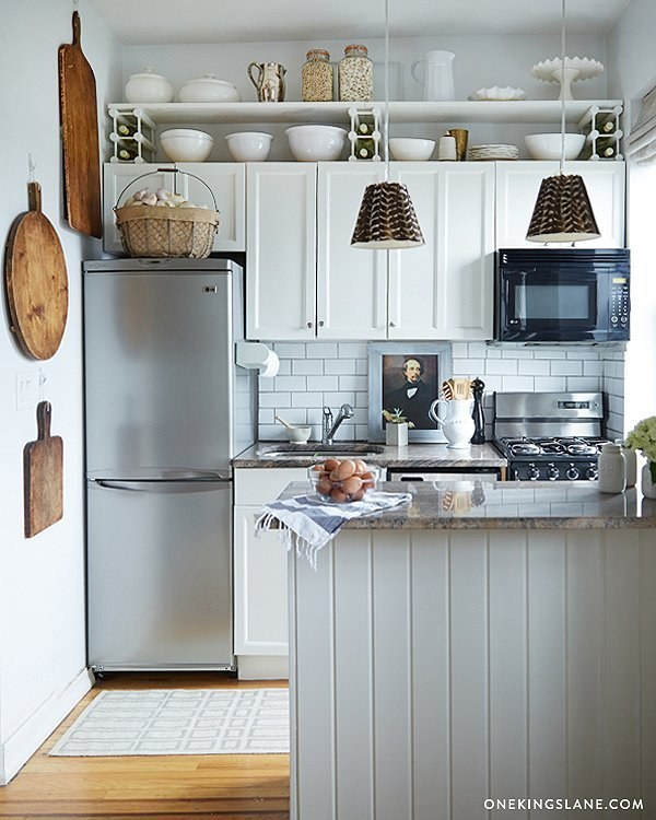Line the area right underneath the ceiling with shelves, especially if your cabinets don't reach all the way up.